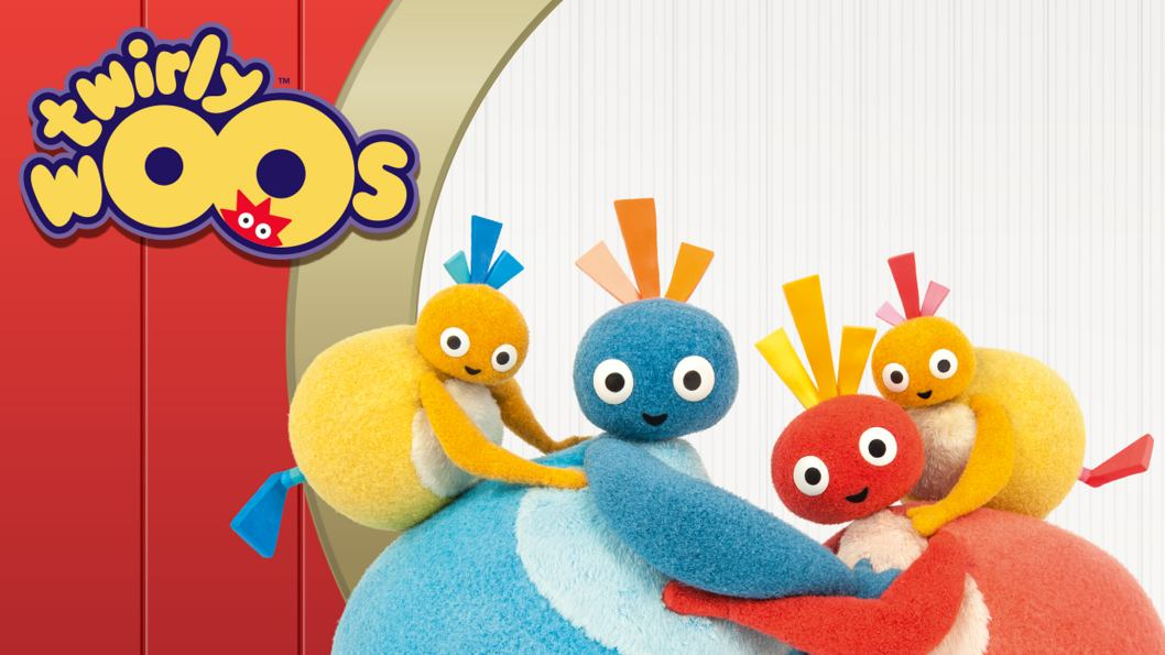 A happy family of four round characters hugging each other in front of a red and white background. Two of the small, yellow characters are hanging off the parents backs and hugging them.