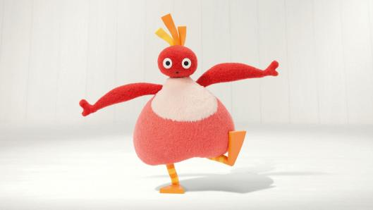 A red, pear-shaped character with a small, round head and orange feet in front of a white background. It has one foot up, arms spread open and a surprised look on it's face.