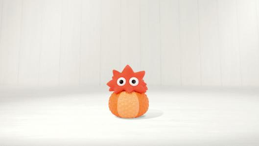 A small, orange character with a round body and star-shaped head in front of a white background.