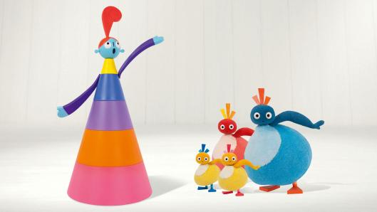 A tall, colourful, cone-shaped character on the left and a family of four round-shaped characters in various colours on the right.