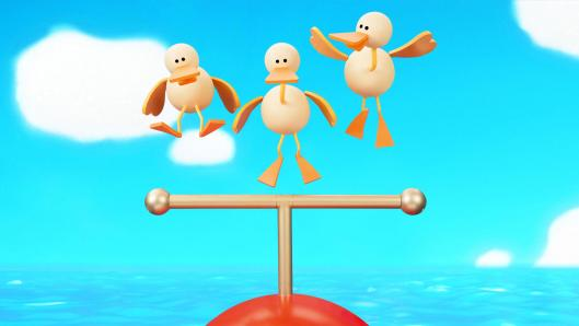 Three beige ducks hovering above a pole with a blue sky in the background.
